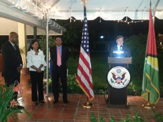 US Ambassador to Guyana Brendt Hardt at the lectern. Others are (L to R) President of the Guyana Press Association, Gordon Moseley; Mrs Hardt and Attorney General, Anil Nandlall.