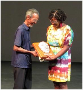 Lifetime Achievement Award winner Clairmonte Taitt (left) accepting his plaque from Zara Warner.