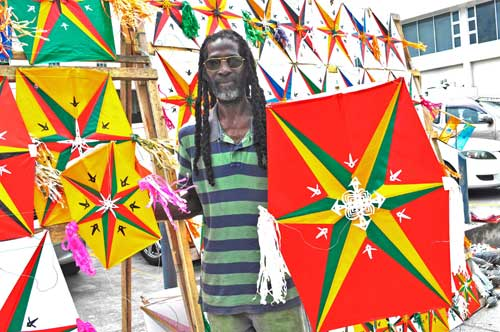Trevor Smith shows off his six-point star kites in Georgetown, Guyana.