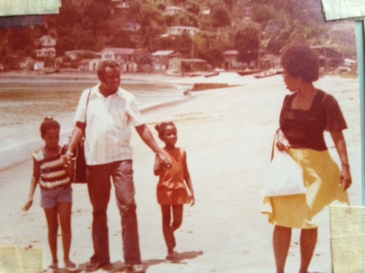 A Guyanese father sharing quality time with his wife and two young daughters while on holiday in Tobago.