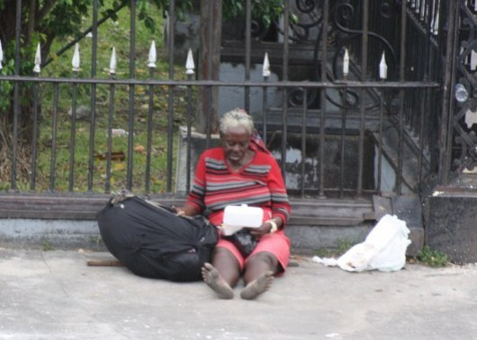 Homeless Woman outside Parliament Buildings - Georgetown - Guyana