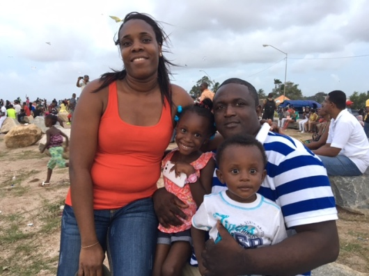 Father with Wife and their Children on the Georgetown Seawalls on Easter Monday 2016.