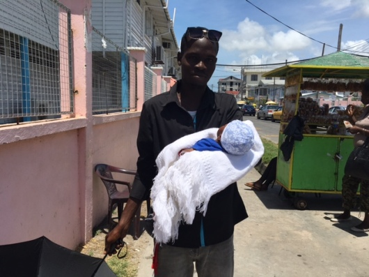 6. A young Father takes his new-born home from the Georgetown Public Hospital, May 2016