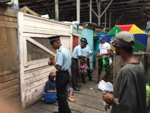 Members of the Guyana Police Force raid the back of the Stabroek Market, where the target was the homeless. June 2016